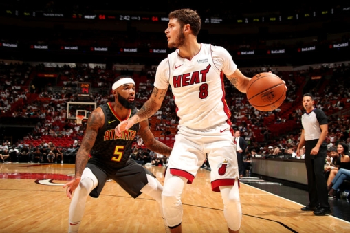 MIAMI, FL - OCTOBER 1: Tyler Johnson #8 of the Miami Heat handles the ball against Malcolm Delaney #5 of the Atlanta Hawks during the preseason game on October 1, 2017 at American Airlines Arena in Miami, Florida. NOTE TO USER: User expressly acknowledges and agrees that, by downloading and or using this Photograph, user is consenting to the terms and conditions of the Getty Images License Agreement. Mandatory Copyright Notice: Copyright 2017 NBAE (Photo by Issac Baldizon/NBAE via Getty Images)