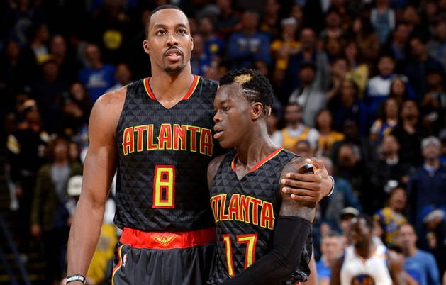 OAKLAND, CA - NOVEMBER 28: Dwight Howard #8 shares a hug with Dennis Schroder #17 of the Atlanta Hawks during the game against the Golden State Warriors on November 28, 2016 at ORACLE Arena in Oakland, California. NOTE TO USER: User expressly acknowledges and agrees that, by downloading and or using this photograph, user is consenting to the terms and conditions of Getty Images License Agreement. Mandatory Copyright Notice: Copyright 2016 NBAE (Photo by Noah Graham/NBAE via Getty Images)